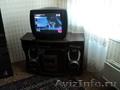 Телевизор LG и тумбочка под него